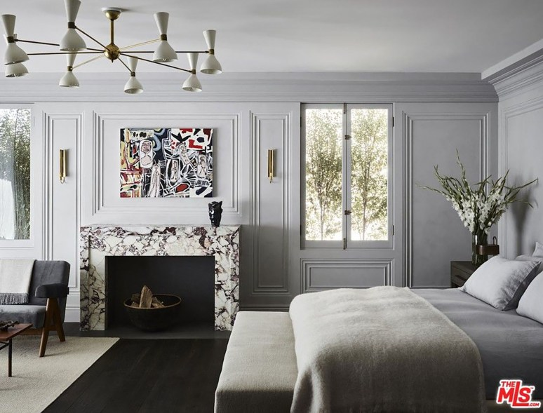 This bedroom has a marble fireplace.