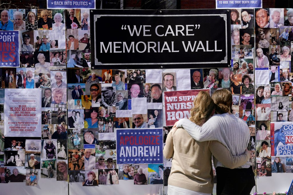 Theresa Sari, left, and her daughter Leila Ali look at a section of a memorial wall