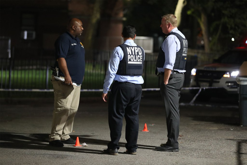 NYPD Crime scene detectives at the scene of a double shooting in the Bronx on Aug. 31, 2021.