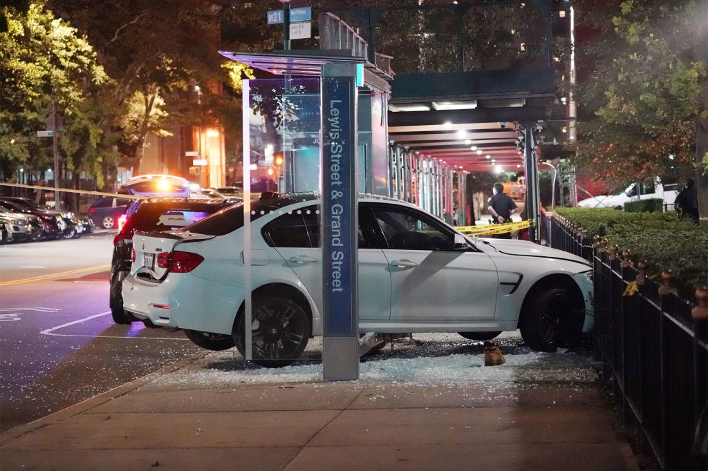 Police at the scene where a pedestrian that was sitting at a bus stop was struck by a vehicle on Lewis Street near Grand Street on Sept. 2, 2021.