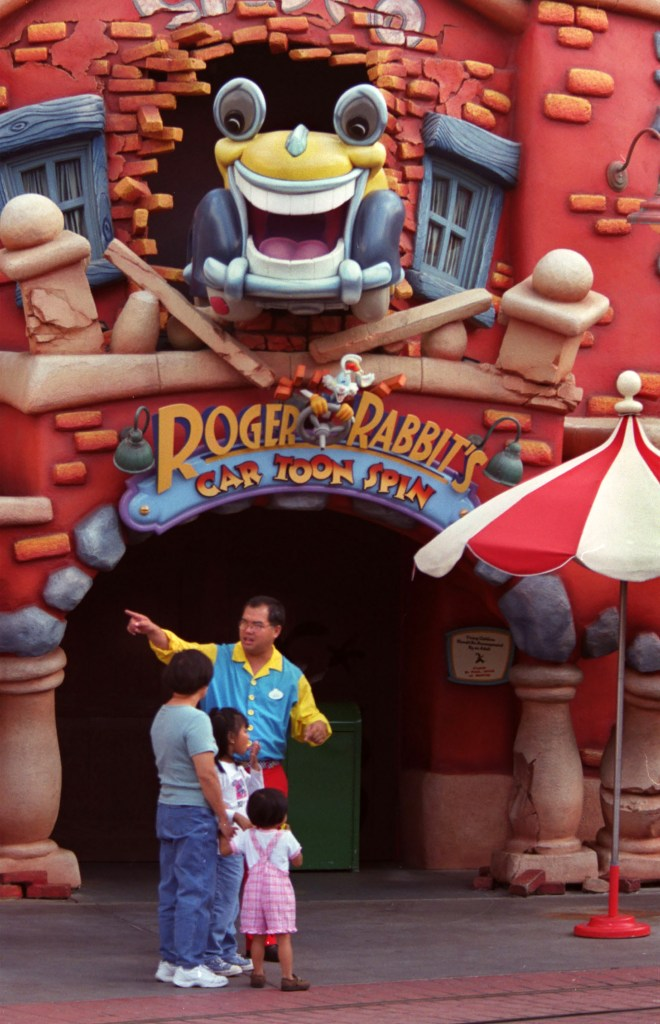 A Disneyland employee outside of the Roger Rabbit's Cartoon Spin ride.