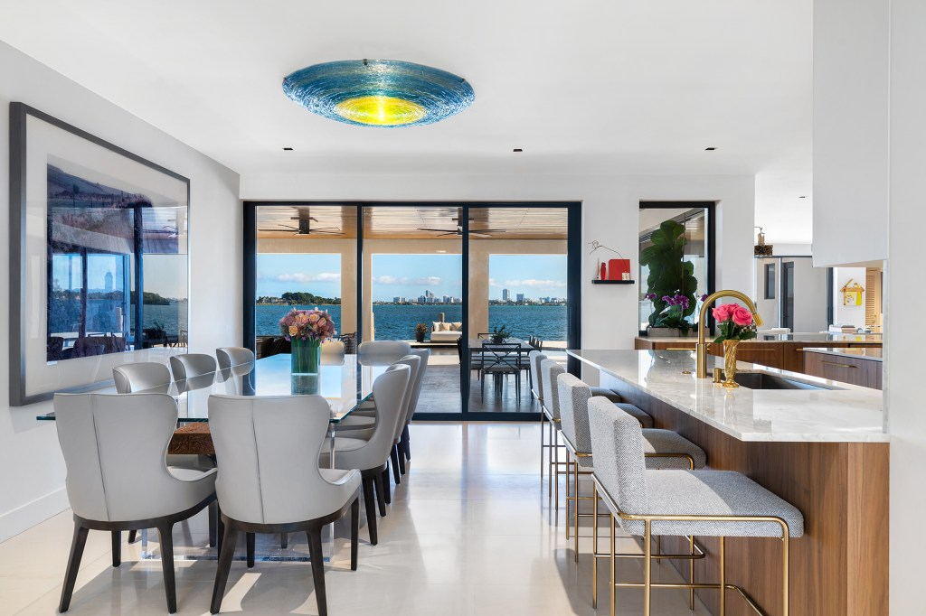 A dining and kitchen area inside the home.