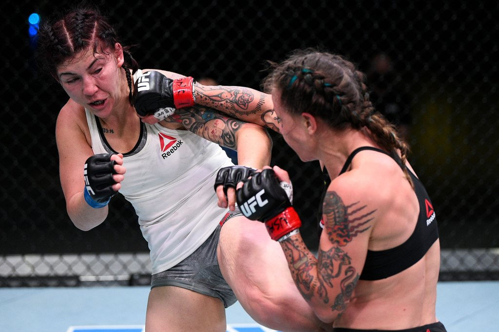 Jessica-Rose Clark of Australia punches Sarah Alpar in their bantamweight bout