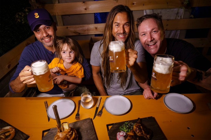 Owner Jeremy Schaller with friends at his Oktoberfest popup.