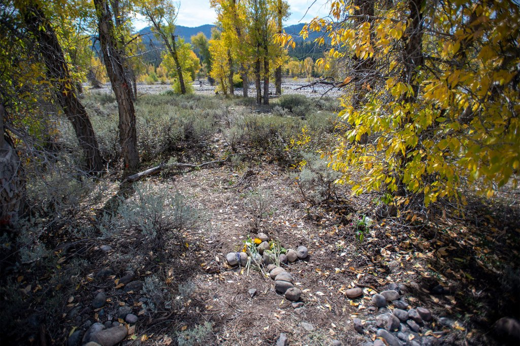 """A stone cross marks a spot in Bridger-Teton National Forest, where the remains of Gabrielle """"Gabby"""" Petito were discovered."""