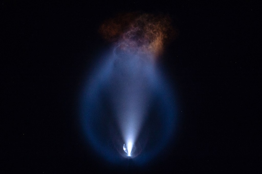 The SpaceX Falcon 9 rockets up into Earth's atmosphere after blasting off from the Kennedy Space Center on September 15, 2021.