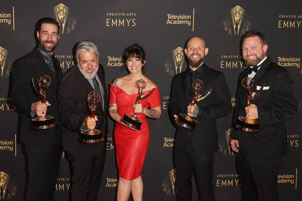 """Cale Thomas (left), Pepa Mora, Samantha Ward, Alexei Dmitriew and Carlton Coleman (right) pose with the award for Outstanding Prosthetic Makeup for """"The Mandalorian."""""""