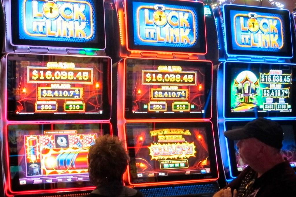 Gamblers play slot machines at a Bally's casino