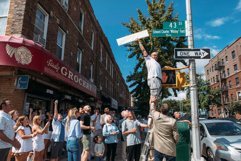 A crowd of people at the unveiling of the street sign honoring Ford in Astoria on September 18, 2021.