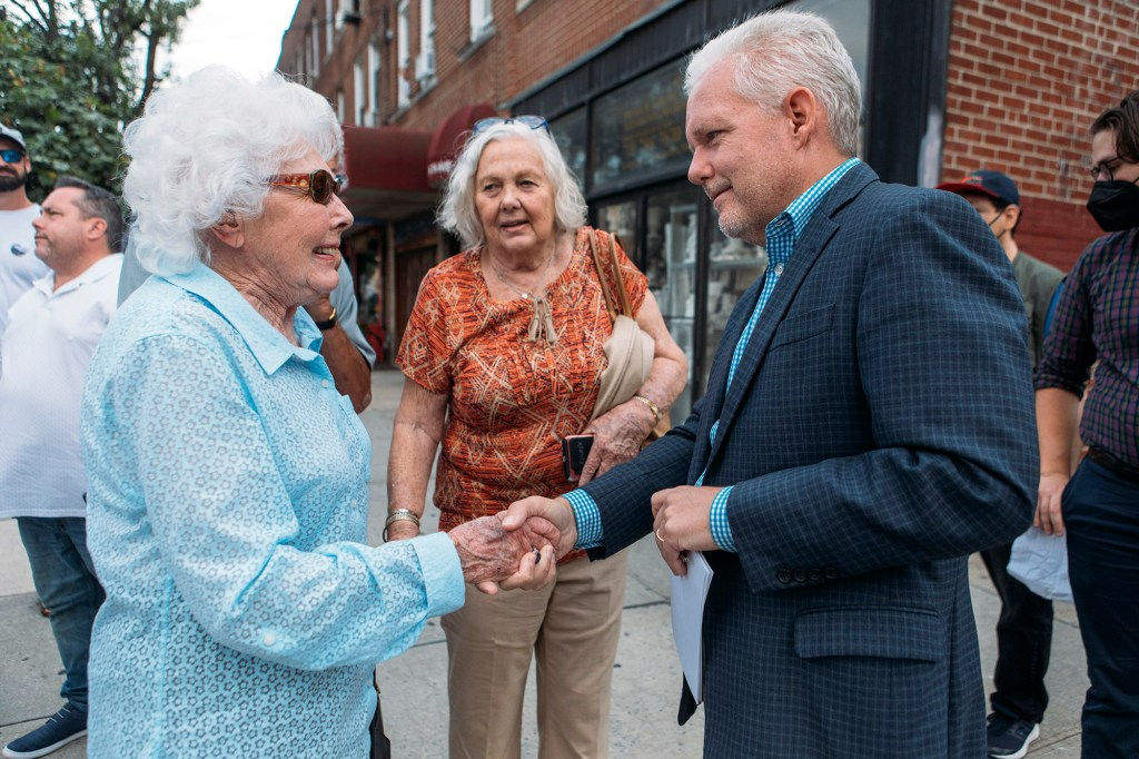 City Council Member Jimmy Van Bramer meeting Ford's widow Joan Ford at the ceremony.