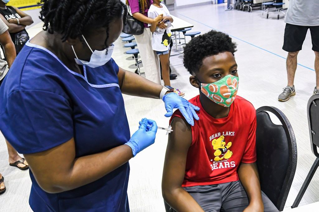 """The children in the trials received two doses of their specially formulated vaccine -- or what amounted to about """"one-fifth"""" of the normal COVID-19 vaccine."""