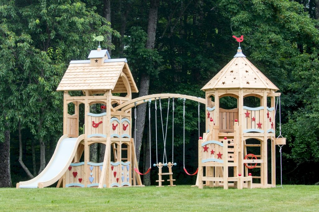 The customizable swing sets also come with a rock-climbing wall, a slide, a spyglass, a bucket that can be pulled up and down by a rope and a play steering wheel, according to the Cedarworks website. The set is decorated in blue and red with birds, hearts and stars.