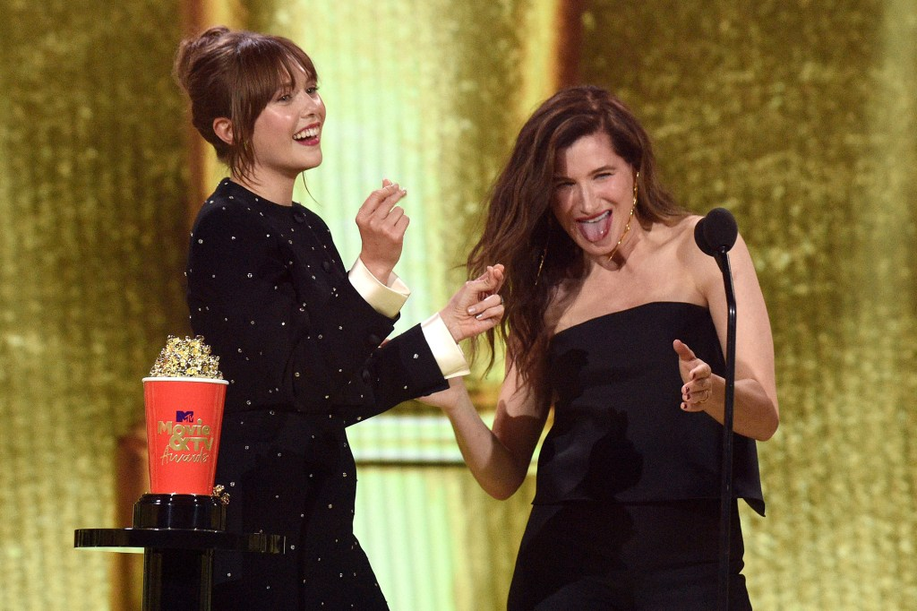 Elizabeth Olsen and Kathryn Hahn accept the Best Show award for 'WandaVision' onstage during the 2021 MTV Movie & TV Awards.