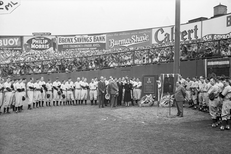 Mayor LaGuardia speaks into the microphone in praise of Lou Gehrig, the late first baseman of the new York Yankees at ceremonies today during which a monument was unveiled in honor of the slugging first baseman and long-time playing captain of the team.