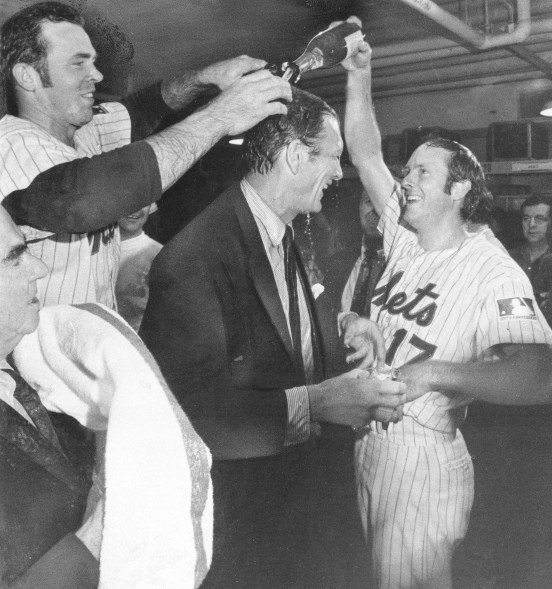 New York Mets Jerry Grote, left, and Rod Gaspar douse New York City Mayor John Lindsay with champagne after the Mets won the National League pennant against the Atlanta Braves, Oct. 6, 1969.