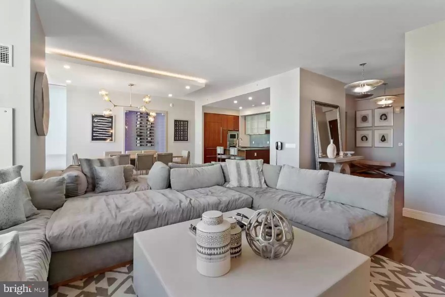 The apartment is filled with custom furniture designed by Widell + Boschetti, which is advertised as part of the listing.