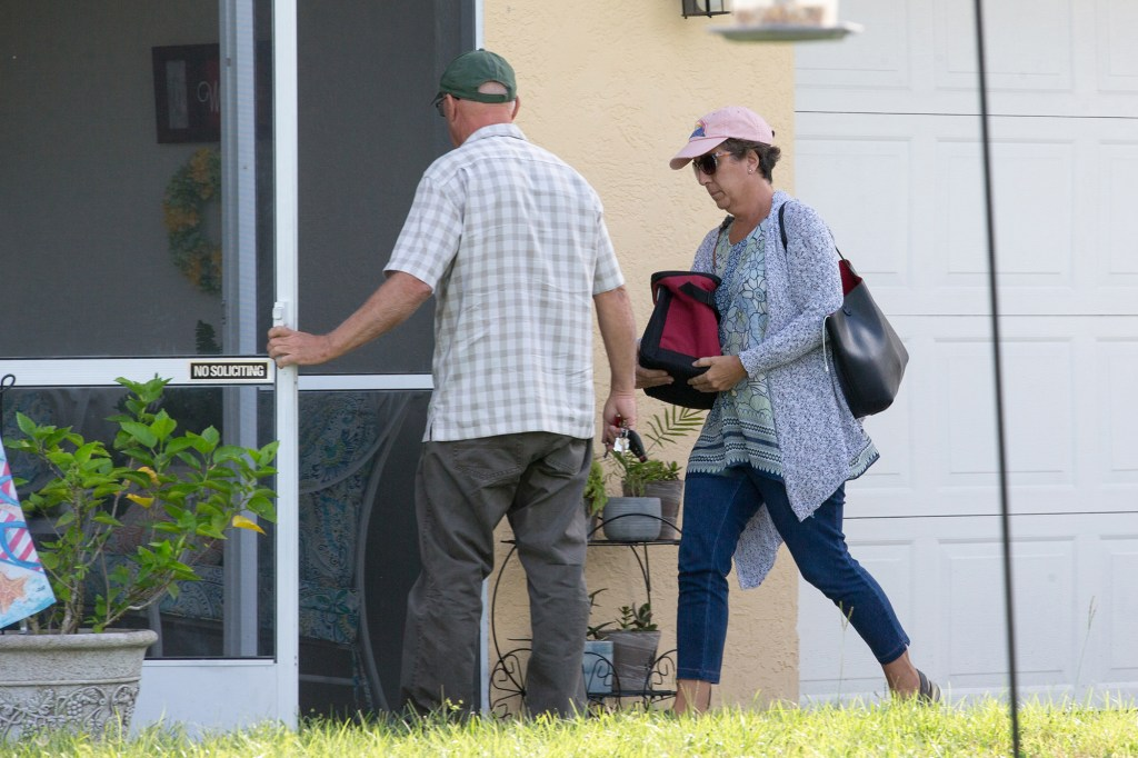 Brian Laundrie's parents, Christopher and Roberta, head into their home in North Port, Florida on September 23, 2021.
