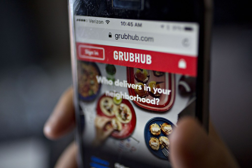 A smart phone with the Grubhub app on the screen.