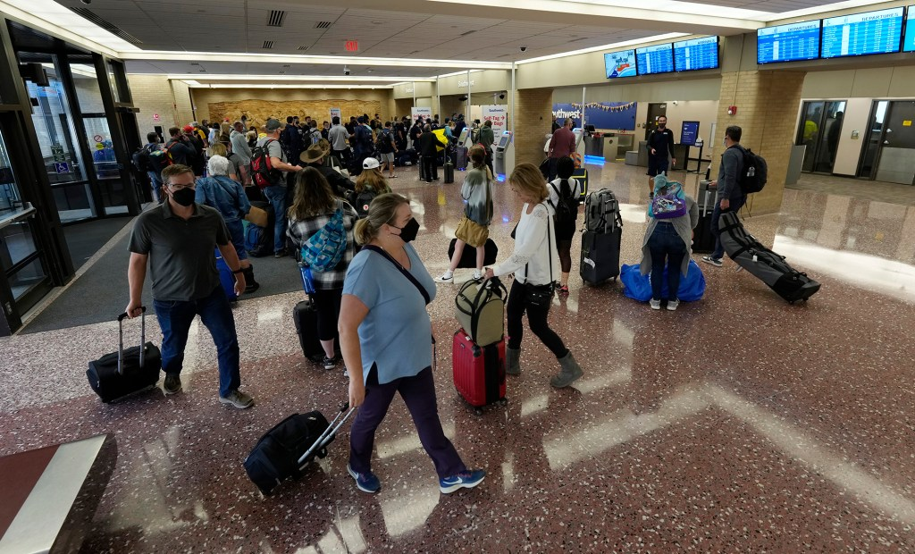 Passengers queue up at the ticketing counter for Southwest Airlines.