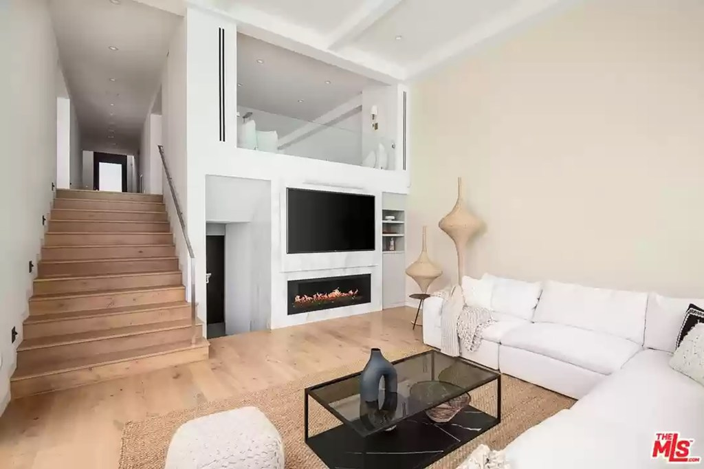 A gas fireplace is in the living room.