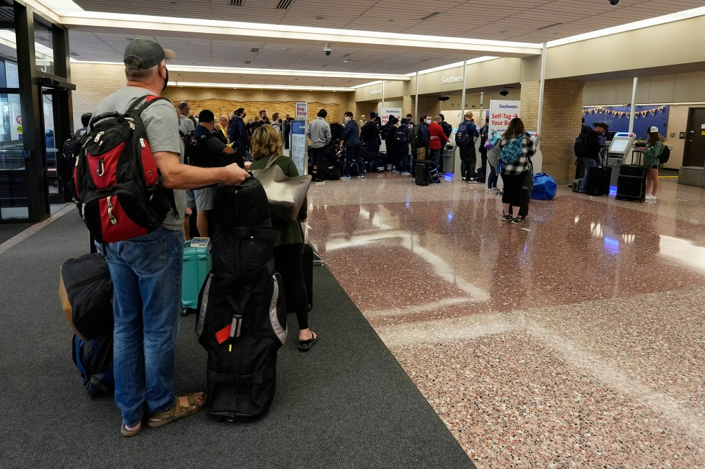 Passengers line up at the ticketing counter for Southwest Airlines flights at Eppley Airfield in Omaha, Nebraska on Oct. 10, 2021.