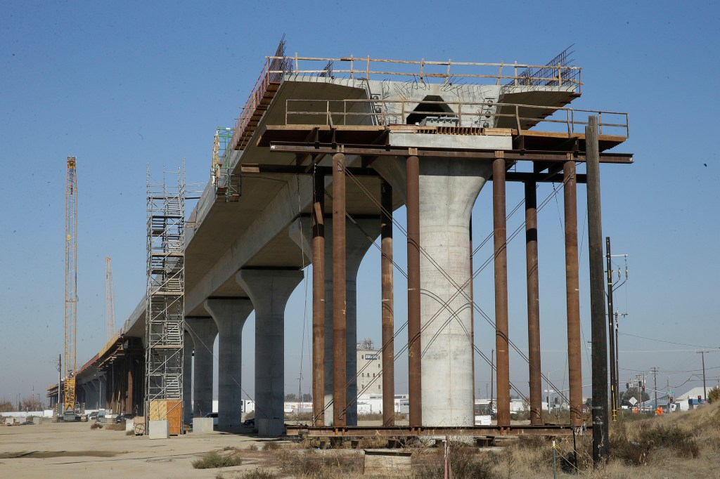 In this Dec. 6, 2017 file photo, one of the elevated sections of the high-speed rail is under construction in Fresno, Calif.