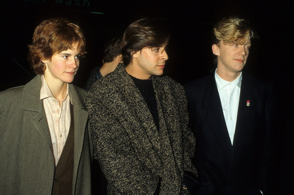 """""""The Breakfast Club"""" stars Ally Sheedy, actor Judd Nelson and Hall posed at a press event in 1986."""