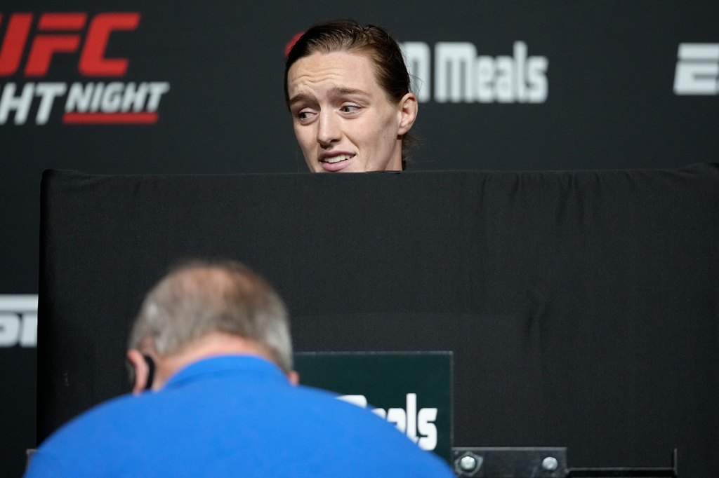 Aspen Ladd attempts to make weight during the UFC Fight Night weigh-in
