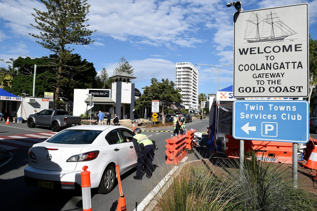 Police are seen directing motorists at the Coolangatta border check point