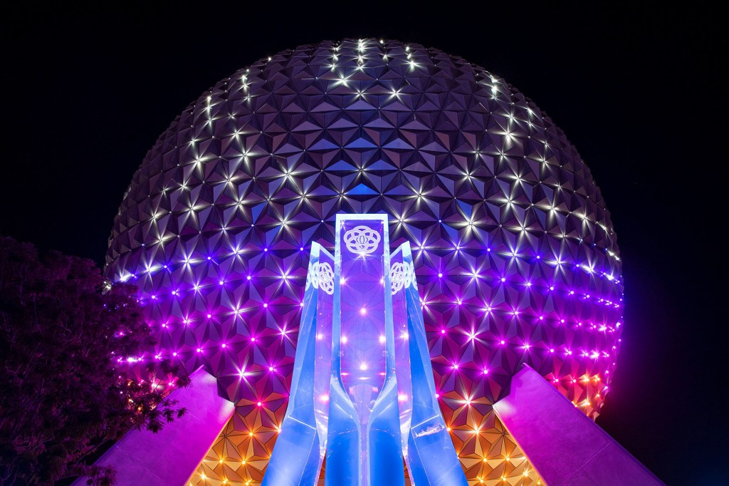 """""""Beacons of Magic"""" projections over Spaceship Earth in Epcot.""""Beacons of Magic"""" projections over Spaceship Earth in Epcot."""