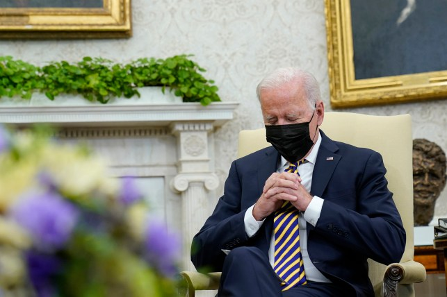 President Joe Biden listens as Kenyan President Uhuru Kenyatta speaks.
