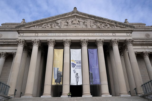 A security worker sits at the National Archives along the National Mall in Washington, D.C., U.S., on Monday, Jan. 18, 2021.