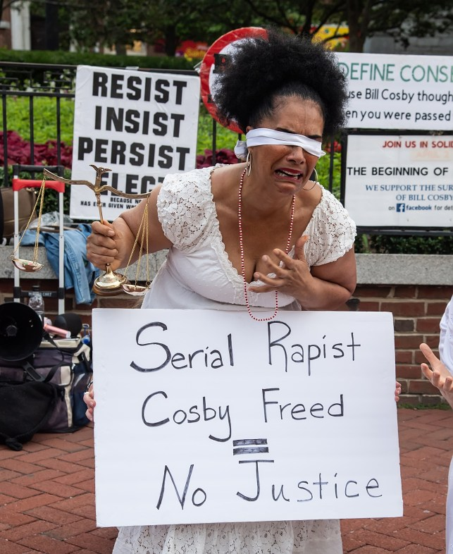 Lilly Bernard, a survivor of Bill Cosby's sexual assault, joins a vigil for survivors in protest of Bill Cosby's reversal at Independence Hall on July 10, 2021.