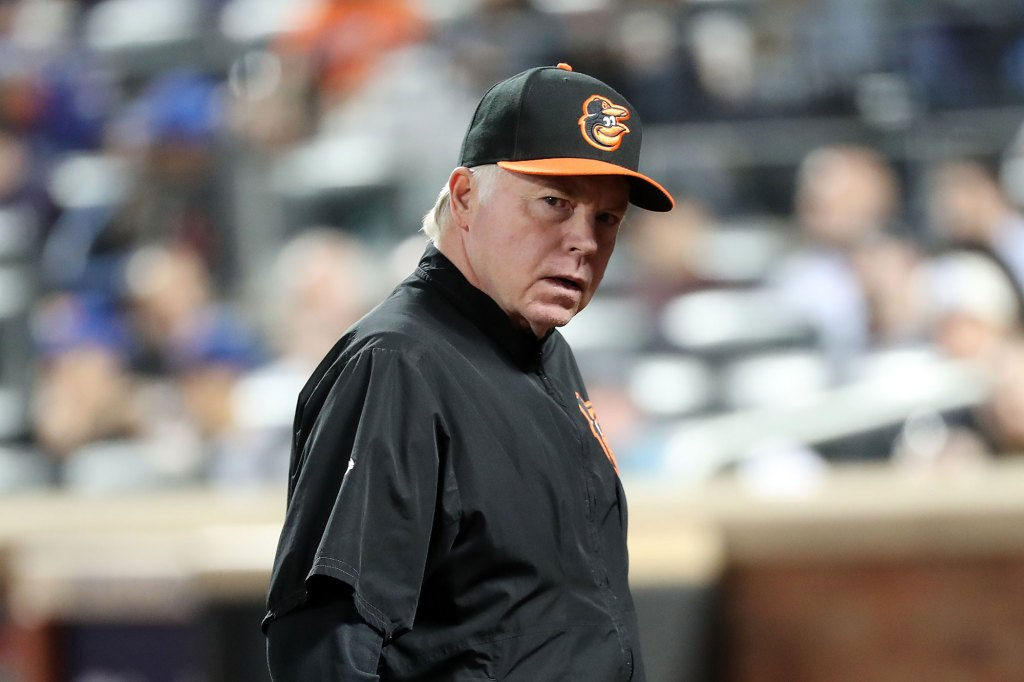 6/5/18 - Baltimore Orioles vs. New York Mets at Citi Field - Baltimore Orioles manager Buck Showalter #26 walking off the field after making a pitching change in the 8th inning.