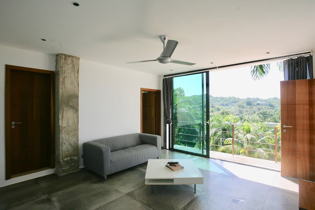 A living room with sliding glass doors is pictured.