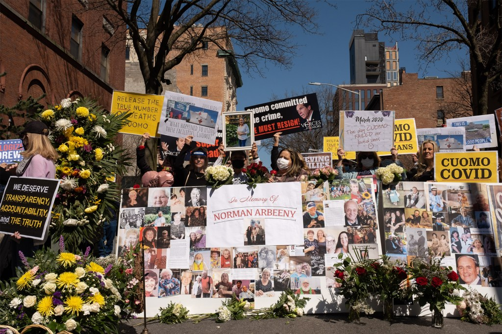 People attending a memorial and rally for COVID-19 nursing home victims in Brooklyn on March 21, 2021.