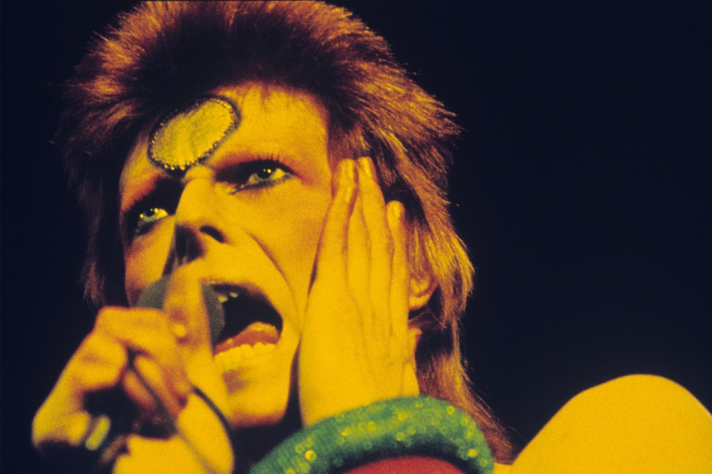"""Glam rocker David Bowie performs in London during his 1973 """"Ziggy Stardust"""" tour."""