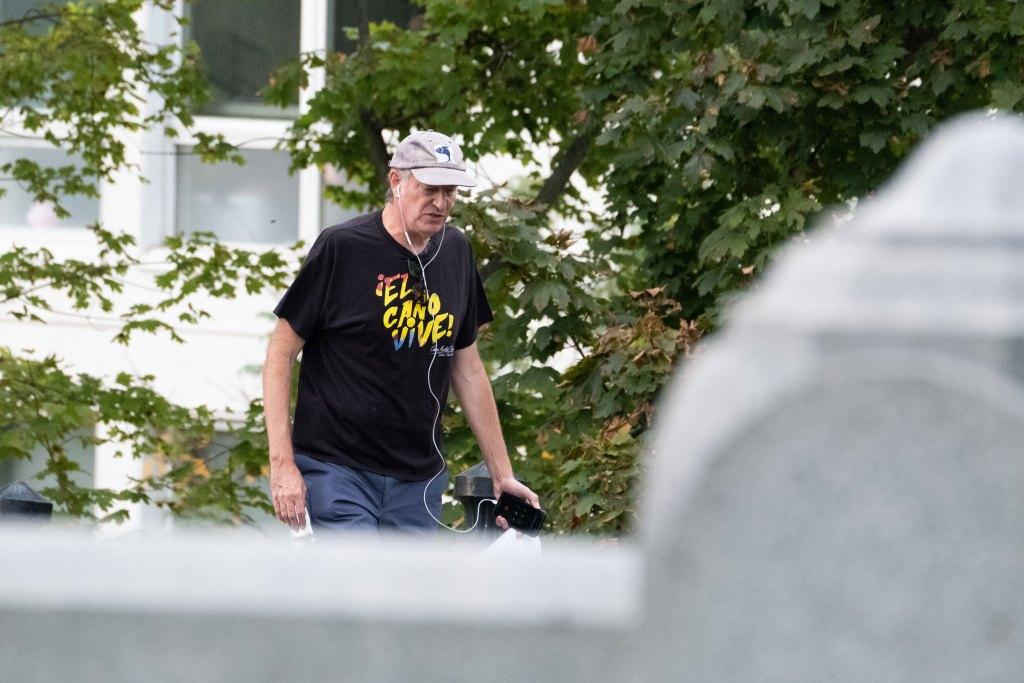 Mayor de Blasio walks in Greenwood Cemetery.