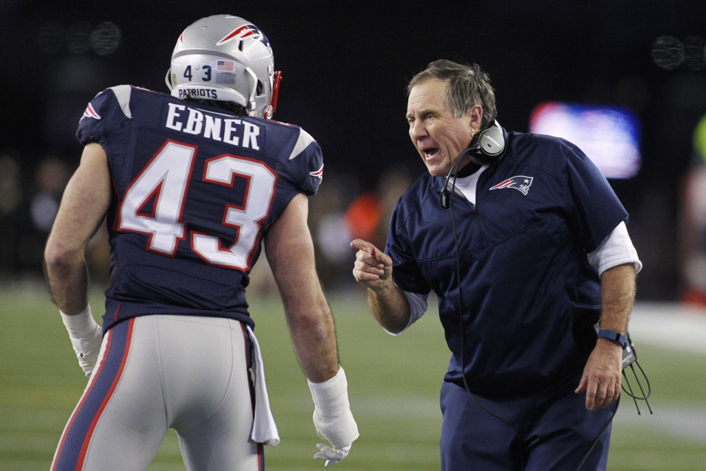 Nate Ebner gets instructions from New England Patriots coach Bill Belichick.