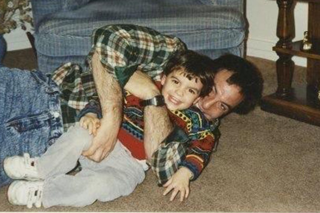 Nate Ebner as a boy gets a playful hug from his father, Jeff.