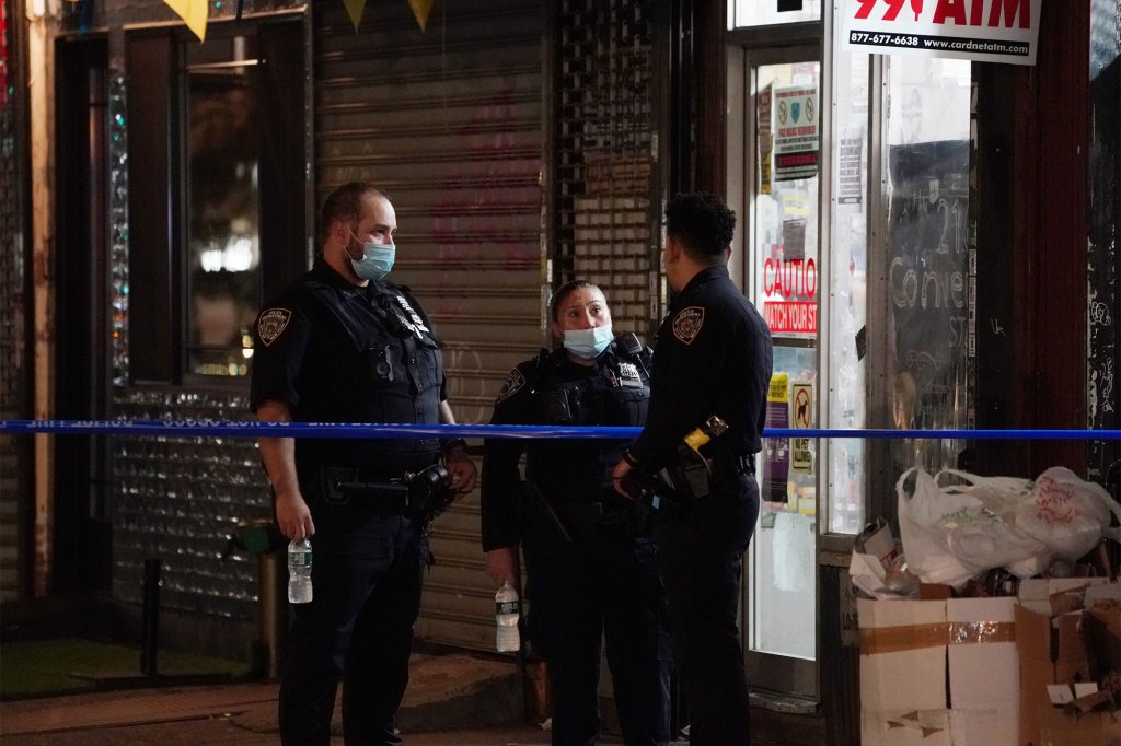 Police investigate the shooting.