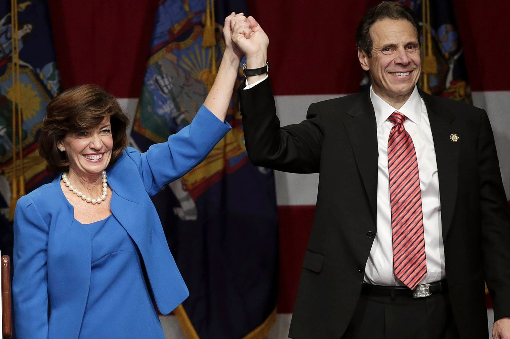 Gov. Andrew Cuomo and Lt. Gov. Kathy Hochul celebrates on the stage after their reelection at the Sheraton New York Times Square Hotel in New York City on November 4, 2014.