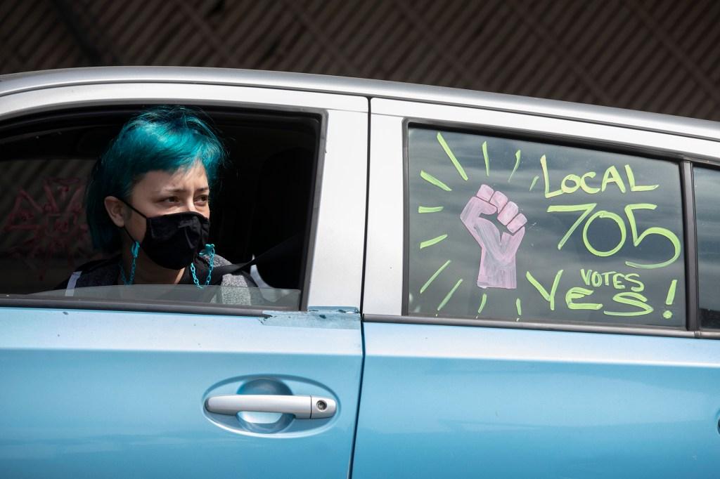 Pro-labor slogans on a car.