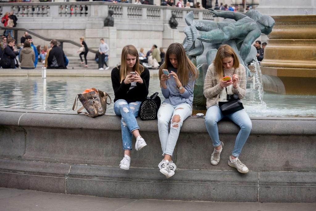 Teen girls using phones