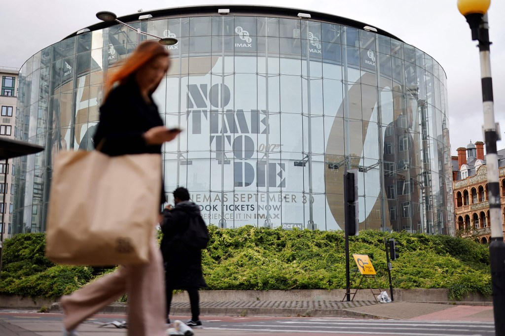"""A pedestrian walks past a billboard of the latest James Bond film """"No Time To Die"""" in London"""