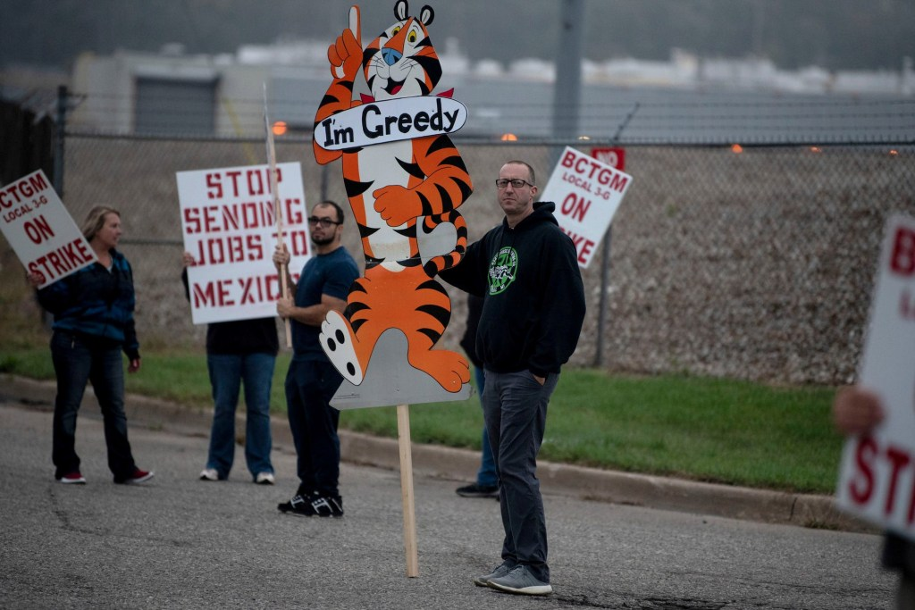 Travis Huffman joins other BCTGM Local 3G union members in a strike against Kellogg Co. at the Kellogg's plant on October 5, 2021.