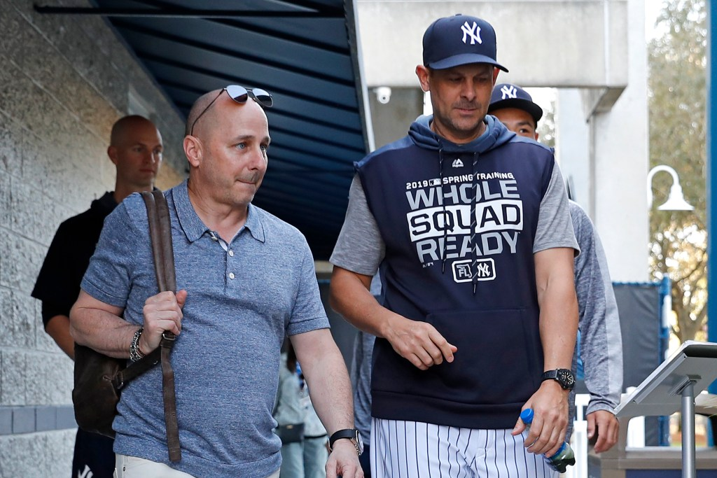 Brian Cashman (left) and Aaron Boone