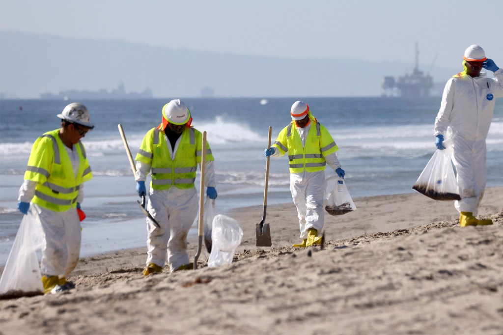 Clean up workers on Huntington Beach on October 5, 2021.