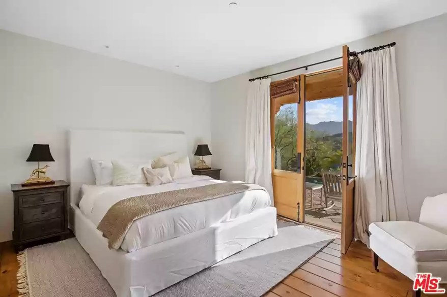 A second bedroom is pictured.