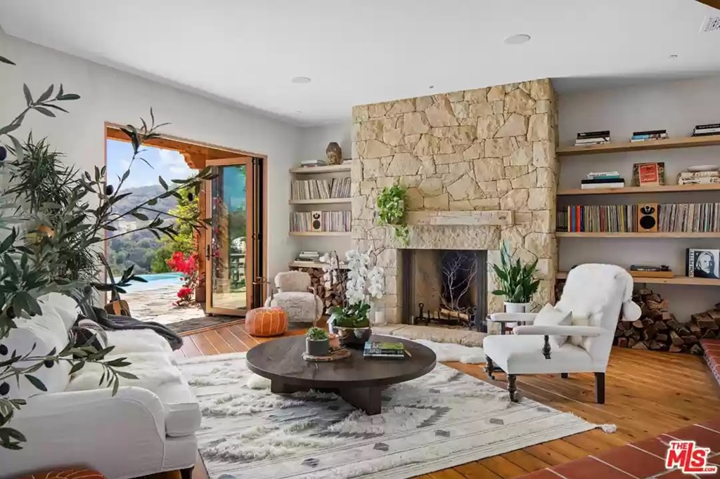The family room has a stone fireplace.